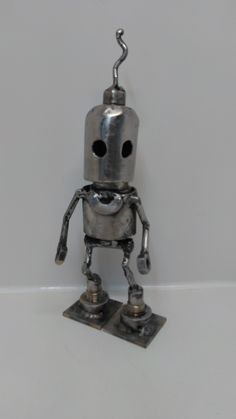 Based off art matt dixon Metal Art Sculpture, Art Sculptures, Scrap Metal Art, Decorative Bells, Recycled Robot, Junk Art