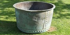 A large copper planter in generally good condition with studded seams and an attractive verdigris patination.