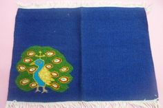 Name of the product –Table Mat  Material – Wool,Tana, Synthetic thread  Size -18x12  Time frame – Four days  Cost – Rs 300/-