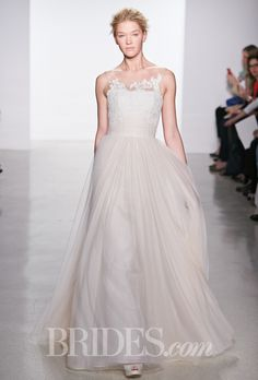 Brides.com: Christos - Spring 2015. Sleeveless blush tulle ball gown wedding dress with an illusion high neckline and corded lace details, Christos