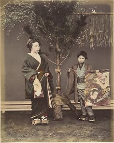 [A Japanese Woman and a Japanese Boy in Traditional Dress]  Shinichi Suzuki  (Japanese, 1835–1919)  Date: 1870s Medium: Albumen silver print from glass negative