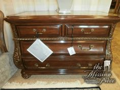 Marge Carson bombe chest in a rich wood with hand painted gold gilding and a marble top. Measures 42*21*31. Two in store at time of posting. Retails currently for $3,475.