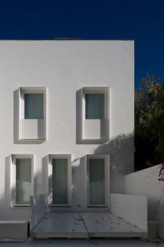 House at Janelas Verdes by Pedro Domingos. Beautiful simple facade.