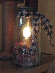 Quart Mason Jar Candle Lamp Bring a touch of primitive country charm to your decor by adding this Quart Mason Jar candle lamp to an end table or hutch. This pale green glass Quart Mason Jar Candle Lam Quart Mason Jars, Mason Jar Candles, Mason Jar Crafts, Mason Jar Lamp, Bottle Crafts, Glow Stick Jars, Glow Jars, Glow Sticks, Bottle Chandelier