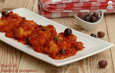 Filetti di nasello al pomodoro olive e capperi