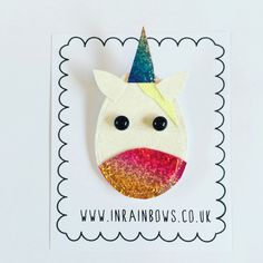 A glitter, unicorn brooch to cheer up your jackets, jumpers and blouses. This sparkly, rainbow unicorn has been sewn up on the sewing machine.  It has a white back and a badge pin to fasten it to your desired clothing choice.  From the top of her horn to the bottom of her mouth she measures 8.5 cm tall and 5 cm wide. The pin is 2 cm wide.  ***please note that the holographic fabric used on the unicorns horn and mouth varies in rainbow colours. It depends where the cut has been made on the…