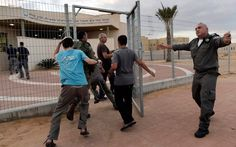 Israeli soldiers and civilians run to a rocket shelter in Neva settlement as a siren sounds signalling an attack coming from the nearby Gaza Strip /Tsafrir Abayov/AP Gaza Strip, Soldiers, Shelter, Lebanon