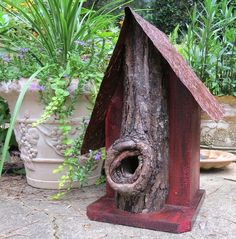 Unique Birdhouse with natural predator guard in jewel tone red Reclaimed wood form North Georgia is used to create this rustic bird house. Natural cavity log front with deep entry provides the perfect