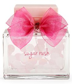 Our irresistibly sweet Sugar Rush Fragrance perfectly matches your charming personality! This deliciously girly blend incorporates red berries, tart pomegranate and fresh florals with a base of rich caramel, musk and white wood.<br><br>1.7 fl oz.<br>Contains alcohol.<br><br>Style: 6100. Imported.