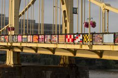 more GREAT pics of the andy warhol bridge yarn bombing AND some of the people who worked on it!!! 30 Amazing Photos of the Warhol Bridge Yarn Bombing.....
