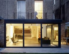 Nice lower level extension and balconies. Wraparound glass really works well. www.methodstudio.london