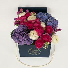 Цветы в шляпной коробке Ранункулюсы