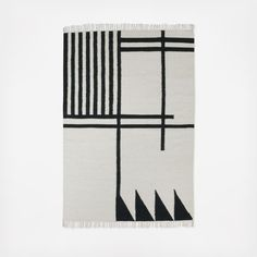 Make a bold statement in any room with this graphic kelim rug.