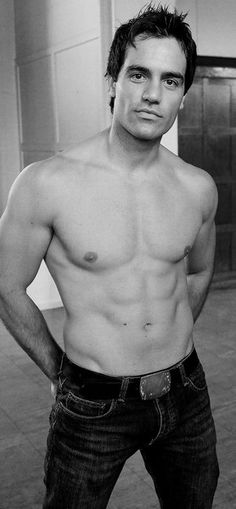 Ramin Karimloo...he's played the Phantom, and been in Les Miserables, and looks like that. He's an amazing singer and looks like this. Need I say much more?