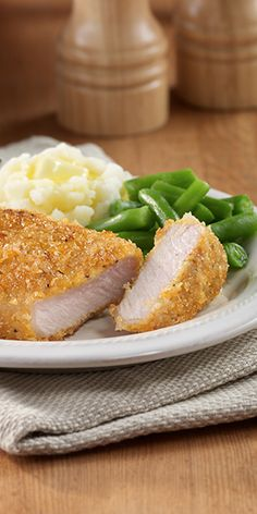 Savory boneless pork chops coated with spicy brown mustard and panko crumbs, pan fried to crisp the breading