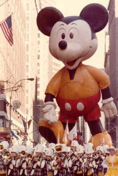 Mickey Mouse- Classic character Mickey Mouse made his debut in the 1934 Macy's Thanksgiving Day parade. Here's a look at the famous Disney character in the (Photo credit: Macy's). JW North HS, Riverside, CA Macys Thanksgiving Parade, Vintage Thanksgiving, Vintage Holiday, Happy Thanksgiving, Mickey Mouse Balloons, Disney Balloons, Tsumtsum, Coral, Vintage Disney