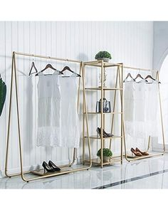 We've got great savings on fashion mental garment clothes display racks, retail free standing clothing rack, hanging clothes display shelves for cloth store,gold from Homedesign-US. Standing Clothes Rack, Metal Clothes Rack, Diy Clothes Rack, Hanging Scarves, Hanging Clothes, Hanging Organizer, Hanging Racks, Display Shelves, Storage Shelves