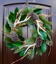 Christmas wreaths, antler wreath, burlap and magnolia wreath  This 24 Christmas wreath with antlers is definitely in my top 3 favorite wreaths! It has just enough of a rustic touch with the faux antlers, burlap ribbon, pine cones, and magnolia leaves. The pine branches and pine cones are slightly iced for that wintry look without being overdone. If you live in the South, you are familiar with thin slivers of ice on the pine trees over the winter months! This wreath is right at home on your…
