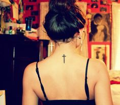 Image from http://www.cooltattoos.us/wp-content/uploads/2013/05/Simple-Cross-Tattoo-on-Upper-Back.jpg.