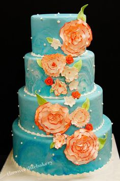 Coral & teal wedding cake design.