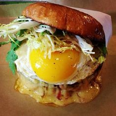 "Burger, meet Brunch: ""Pig Champion"" burger from LA's Grill Em All, w/ Canadian bacon, fried egg & champagne hollandaise"