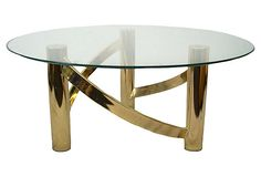 Stunning coffee table with a sleek round brass base. Top is glass and is removable.