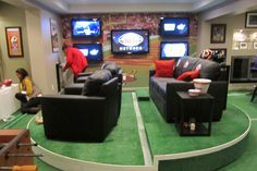 Multiple flat screen TVs in the Front of the Hydraulic Man Cave