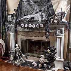 Create a creepy #HalloweenMantel with skulls and spider webs #HalloweenDecor. {Found on Pinterest}