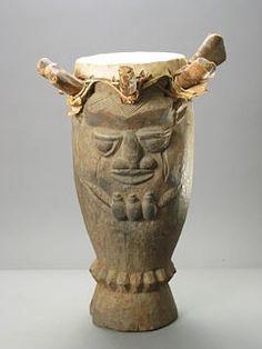 "Yoruba Wooden Drum - PF.4700 Origin: Southwestern Nigeria Circa: 19 th Century AD to 20 th Century AD  Dimensions: 24"" (61.0cm) high x 17.5"" (44.5cm) wide  Collection: African Art Medium: Wood and Animal Hide  $7,500.00  Location: United States"