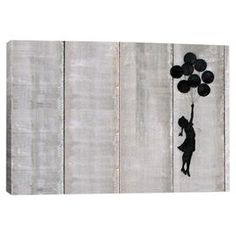 Perfect as a delightful focal point or part of a lovely vignette, this charming canvas giclee print showcases Banksy's Flying Balloons Girl.    Product: Canvas giclee printConstruction Material: Pine wood, cotton canvas and fade-resistant inksFeatures:  Reproduction of art by BanksyComes ready to hang Cleaning and Care: Keep out of direct sunlight and away from heat sources