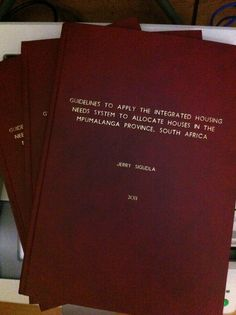UNISA thesis, in maroon.
