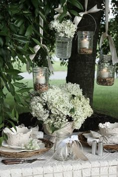 Outdoor party table- like the jars with the candles.  I think using beans would be great too instead of the birdseed.