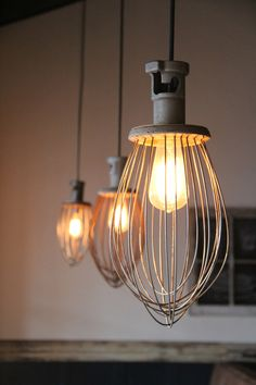 These lights were once industrial whisks that were wired to hold a light socket.