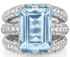 ADLER.     An Aquamarine and Diamond Ring.     Set with a rectangular-cut aquamarine, weighing approximately 10.85 carats, to the tapered three-band pavé-set diamond bombé half hoop, mounted in 18K white gold, size 6. Signed 'Adler'. Philips de Pury.
