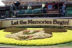 Let the Memories Begin - Magic Kingdom - Entrance garden at the Magic Kingdom. You can see the Walt Disney World Railroad in the background.. Photo by PassPorter member Cam22