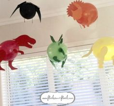Dinosaur balloons for a dinosaur-themed kids party. Aren't they amaze?! Click through to download my FREE dinosaur templates so you can make your own, plus more dinosaur party inspo at Flicker + Flock... or pin for later! x
