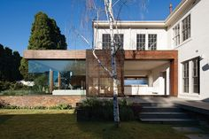 glass pavilion added to a robust interwar Melbourne home, originally built for American military