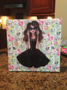 Made this canvas today with mod podge, scrapbook paper, and a printed illustration!