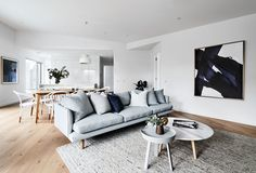"""Freddy sofa, Dining table, Bentwood B9 chairs, Muuto side table, Huset. Artwork """"Indigo #1 Kerry Armstrong. Marble coffee table, Harpers Project. Rug, Halcon Lake. Gubi pendant light, Surrounding."""