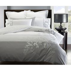 @Overstock - Add simplistic beauty to your bedroom with this three-piece, king-size duvet cover set. This set includes a duvet cover and two king shams. The 100 percent cotton duvet features beautiful silver-tone flowers against a graduated white and gray background.http://www.overstock.com/Bedding-Bath/Ivy-3-piece-King-size-Flange-Duvet-Cover-Set/5249736/product.html?CID=214117 $69.99