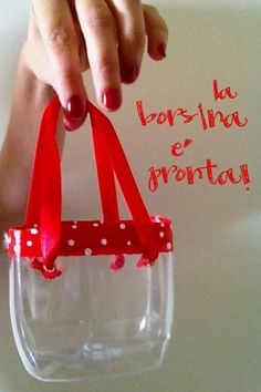 Turn a plastic bottle into a little bag (or leave off the ribbon and use as an art supply holder)