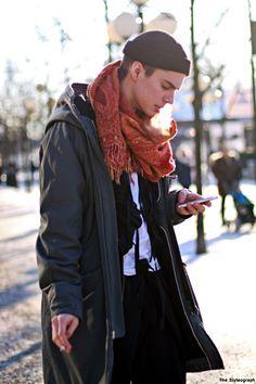 He is working the scarf - effortlessly fashionable and practical. Kungsträdgården, Stockholm, Sweden