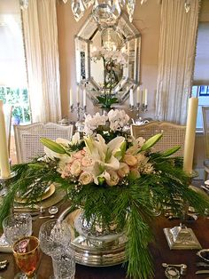 yellow or white pine branches display soft pink roses & white lilies set in a silver vase or champagne bucket.
