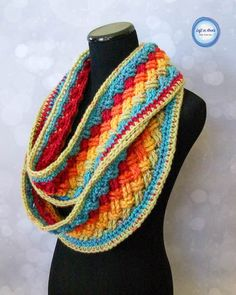 The Celtic weave stitch make a unique woven texture that looks amazing when paired with multiple colors. Fortunately, Caron Cakes yarn does the color striping for you in this infinity scarf. But …