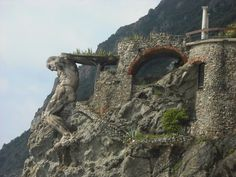This pic really does not do justice to how incredible the stone man really is. Monterosso, Cinque Terre, Italy