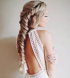 Glam up with a loose side fishtail you can wear on special occasions. It isn't as complicated as some 'dos but it sure looks as elegant as the others.
