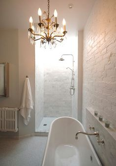 Walk in shower (do they normally hang a curtain?) and tub with built-in shelf.