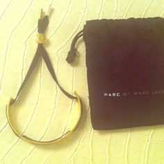 Marc Jacobs friendship bracelet w/ dust bag Marc by Marc Jacobs gold tone friendship bracelet. I purchased it in July from Bloomingdales. Light wear and scratches, it very good condition. Thanks for looking! No trades or paypal. Marc by Marc Jacobs Jewelry Bracelets