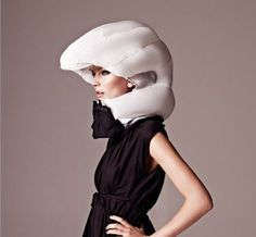 http://www.popsci.com/gadgets/article/2010-10/video-ridiculous-bike-helmet-could-save-your-life-—-and-your-hairdo