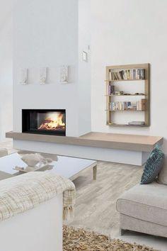 Une cheminée contemporaine avec banquette intégrée
